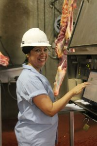 women working in beef packing